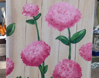 Pink hydrangea on a fence