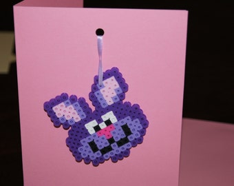 Almost all little girls love pink and purple; big ones too.  Take a look at this Perler Bead purple bunny Easter card!