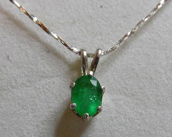 """Columbian Emerald necklace.  8x6mm oval  weighing 1.10ct.  Set in .925 Sterling Silver with 18"""" .925 Sterling Silver chain."""