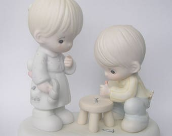 "Precious Moments ""Thumb-body Loves You"" Porcelain Figurine - Enesco - Vintage Collectible - 1990 - Suspended - Hammer and Workbench"