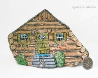Painted rock,painted stone,log house stone,gone fishing,log cabin,cottage rock,painted stone house,rock house,garden decor,miniature house