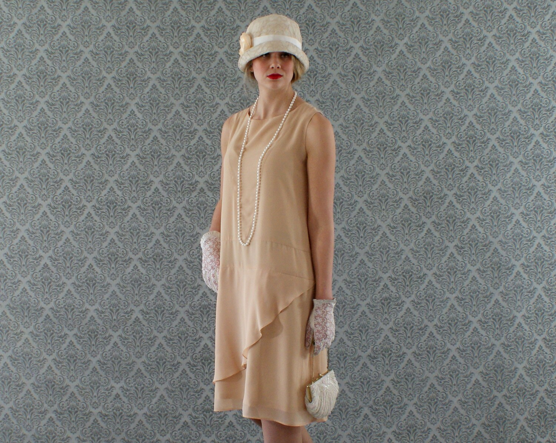 neat dark beige flapper dress with a ruffled skirt detail. Black Bedroom Furniture Sets. Home Design Ideas