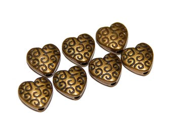 7 Antiqued Bronze Metal Heart Beads