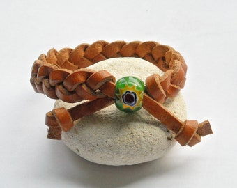 """Brown leather bracelet, braided with green glass sunburst bead. 6.5"""" older boys / kids or womens small braclet size. #D-04."""