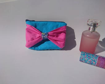 Charming pink purse with blue bow
