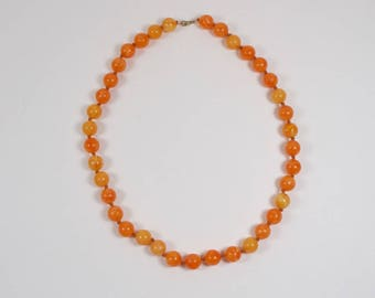 Vintage 1960s knotted orange plastic bead necklace