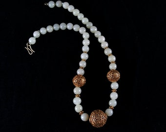 White jade beads and gold necklace