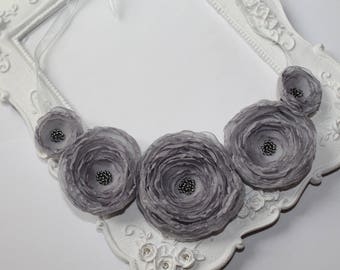 Gray necklace with five silk flowers