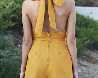 Modern mustard yellow romper/playsuit with bow / trendy + summer + spring