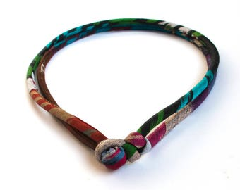 Central Asia ikat necklace Stunning statement fabric jewelry Luxury handwoven textiles Bold and modern