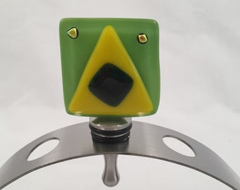 Dichroic shimmers on Amazon Green with yellow triangle bottle stopper for wine, vinegar, olive oil and fine liquor.