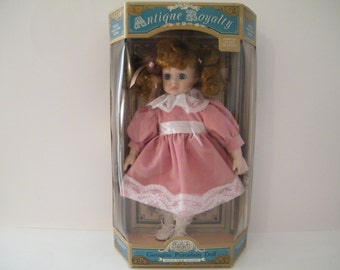 Antique Royalty Porcelain Doll by ANCO, Vintage New in origianal box, her cheeks look wet from tears, sad eyes, ages 8 and up