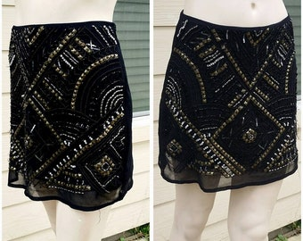 Black mini skirt with beads by Forever 21 size s