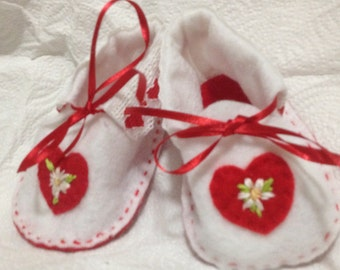 Hand made white booties with red soles and red hearts and red ribbons