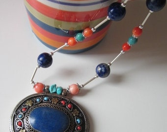 Understated elegance of a silver and lapis exotic necklace.