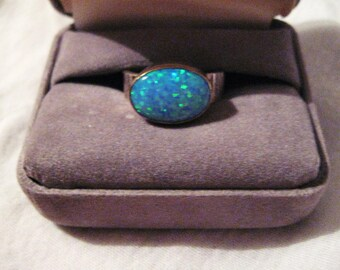 Oval Blue opal with wide silver band and gold stone bezel-sale