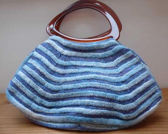 "Roomy fat-bottom handbag made from felted merino and silk yarn, acrylic handles, fully lined, inside pockets, measures 40 x 20cm (16"" x 8"")"
