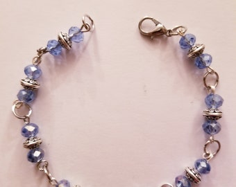 Blue and flat silver beaded bracelet
