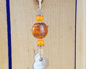 Vintage American Tourister bellhop key pendant with orange beads