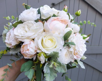Ivory, white and blush pink silk wedding bouquet. Made with artificial roses, peonies, ranunculus, garden style roses and mixed greenery.