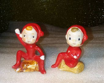 Vintage Hand Painted Set of 2 Christmas Pixie Elves Sitting on Logs
