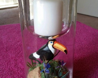 Votive glass candle holder with hand carved toucan bird, handcrafted flowers, and handcrafted base.