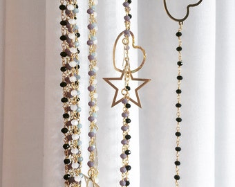 Long rosary with Heart or star.