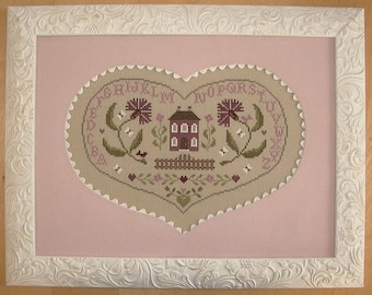At the Heart of the House – French counted cross stitch chart to work in 9 colours of DMC thread.  Heart Shape ABC Sampler.