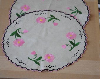 "Two round, hand embroidered, linen table scarves. 15"" diameter."