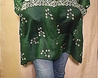 One-of-a-kind 100% up-cycled silk Holiday themed light weight tunic featuring cowl neck and front pocket detail