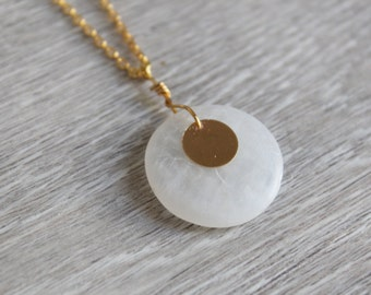 Gold-colored chain with white soapstone pendants