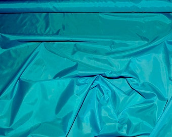 Poly Lining fabric 58 inches wide..Turquoise .. . used for lining  jackets, skirts, dresses. vests, soft, light weight