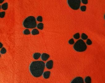 Black Paws on Orange Fleece Fabric (1 yard 25 inches)