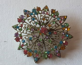 Multi colored brooch, silver tone