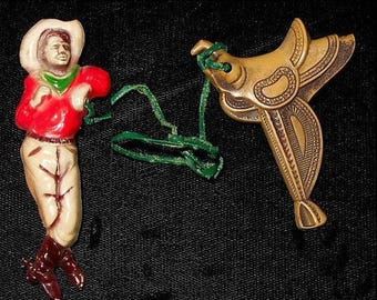 30's Celluloid Cowboy PAIR of Brooches of Hatted Cowboy with Rope Lasso Tied to Second Brooch of Horse's Saddle. TWO Brooches for Only 79.90