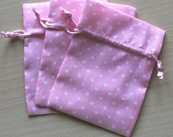 Pink fabric with white polka dots pouch size 9 x 12 cm