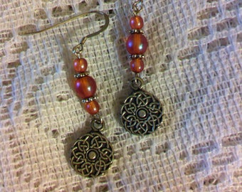 Apricot and silver pierced earrings with Celtic knot charms