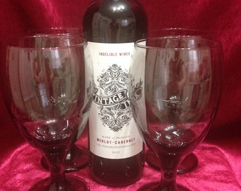 Set oƒ Four Large Black Wine or Water Glasses