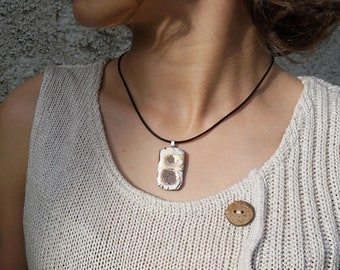 White rectangular pendant, lava rounds and twists of gold enamelled Auvergne volcano lava