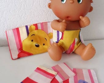 Clutch lined with diaper, wipes, doll and doll.