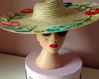 1950 s style natural straw wide brim hat with embroidered flower trim.