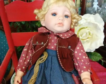 """Vintage 17"""" vinyl doll. Cowgirl baby. Great condition. Blonde hair and blue eyes."""