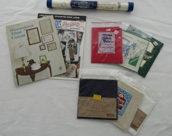 Vintage variety of unique cross-stitch items include 2 pattern books for bookmarks and special occasion decor plus cross stitch fabrics