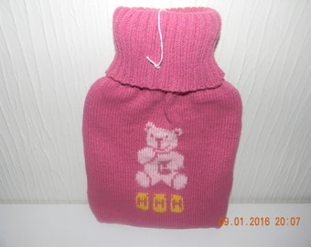 Handmade knitted hot water bottle cover - complete with hot water bottle.