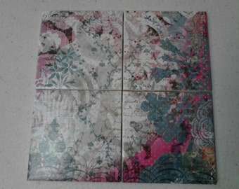 Flowers and script in blues, pinks, and whites. Set of 4 decoupage tile coasters.