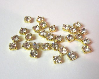4mm Clear Glass Sew on Rhinestones in Gold colored Settings.  50 Pcs