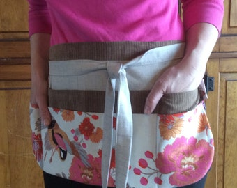 Utility apron made of sturdy cotton and linen. Sewn with quality and care in every stitch.