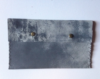 Faded effect leather clutch