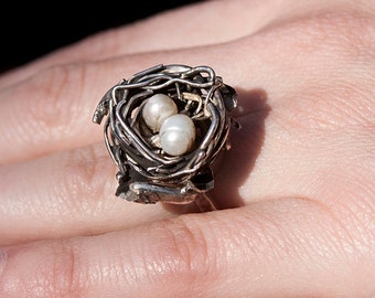 Twin's nest. Silver ring with white pearls. In form of nest with a two cute eggs.