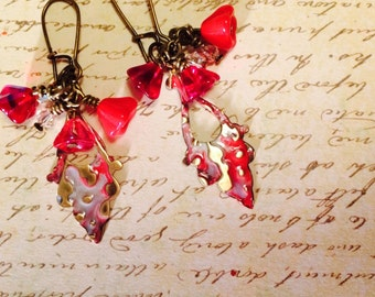 Red Embossed Vintaj Brass Earrings: Cherry red  and white brass, Red Czech flowers and Swarovski crystals dangle on Vintaj brass drops